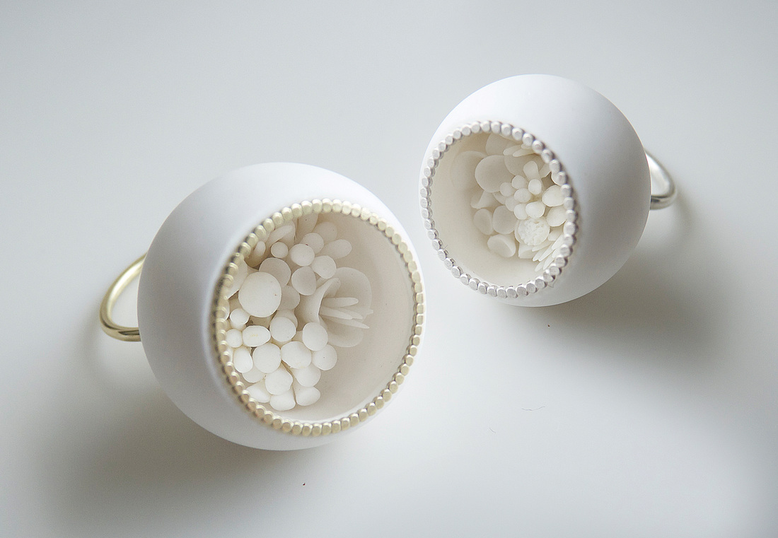 "Ute van der Plaats - collection ""In-between days"". (2016) ring with little porcelain flowers (all handmade) inside - The width of the balls is either 2,5 cm or 3 cm:"